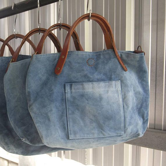 A smaller handbag version of my natural indigo canvas tote bag. Easy to carry with short leather handle or use with the linked strap as a cross body handbag or shoulder bag. Roomy enough to fit a small notebook or tablet with multiple interior pockets and one outside pocket. Fun,