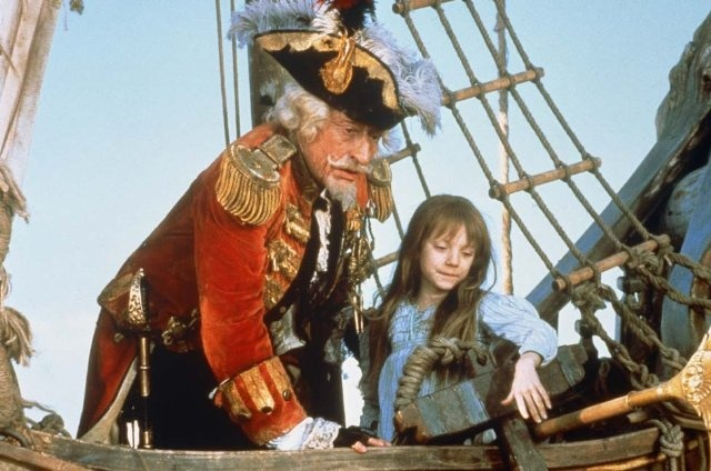 Still of Sarah Polley and John Neville in The Adventures of Baron Munchausen