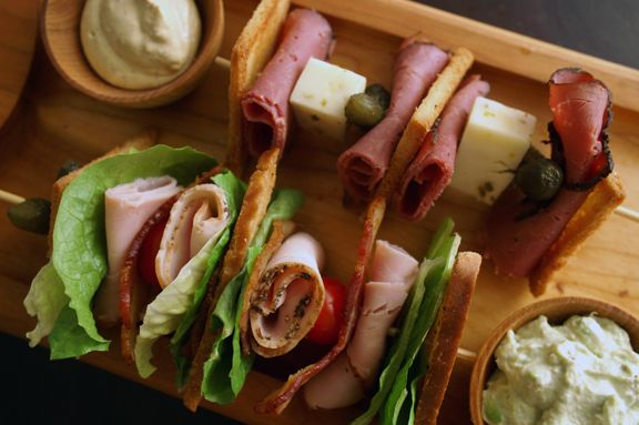 clever party idea: pastrami on rye + club sandwich skewers
