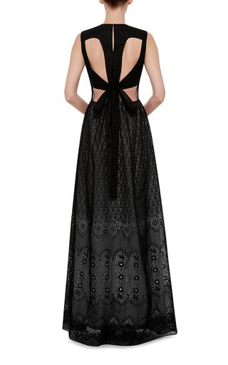 Accolade-winning Italian designer Alessandro Dell'Acqua took his off-beat chic to the sea and the safari for Resort 2016. Crafted entirely in silk, this **No. 21** dress cuts a dramatic, elegant figure with a charming print and an intriguing open-cut back.