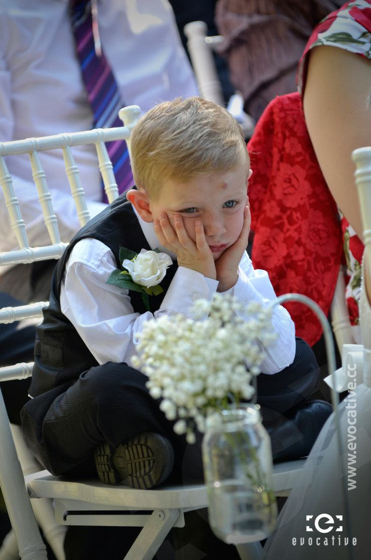 Page boy thoroughly enjoying the wedding ceremony, at Woodlands of Marburg. #WeddingPhotography #Bored