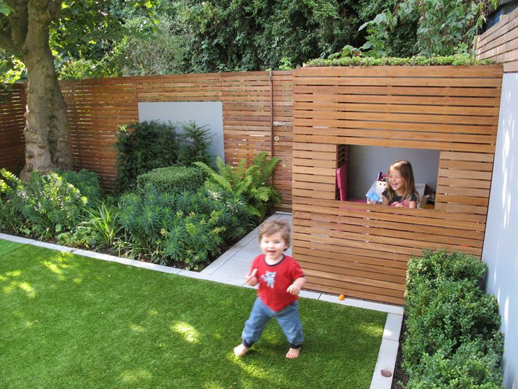 Bespoke playhouse fits perfectly into the space. For the corner opposite to trampoline