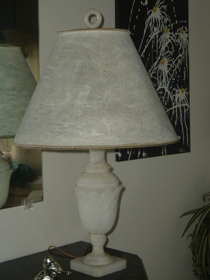 Old marble lamp with milk glass finial.