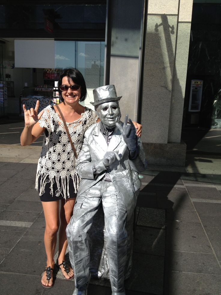 Teaching the street performer the I love You Hand Sign www.intentionalwellbeing.com.au