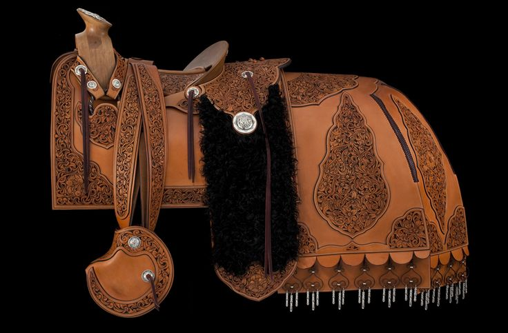 Here's a video put together by John Willemsma describing a little of the history and the inspiration behind his amazing Mexican style saddle from the 2012 Exhibition & Sale.