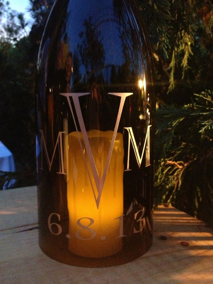 Three letter monogram in Castellar font with no border on the 1.5L burgundy bottle.  This is such an elegant centerpiece. www.wordcouture.com.