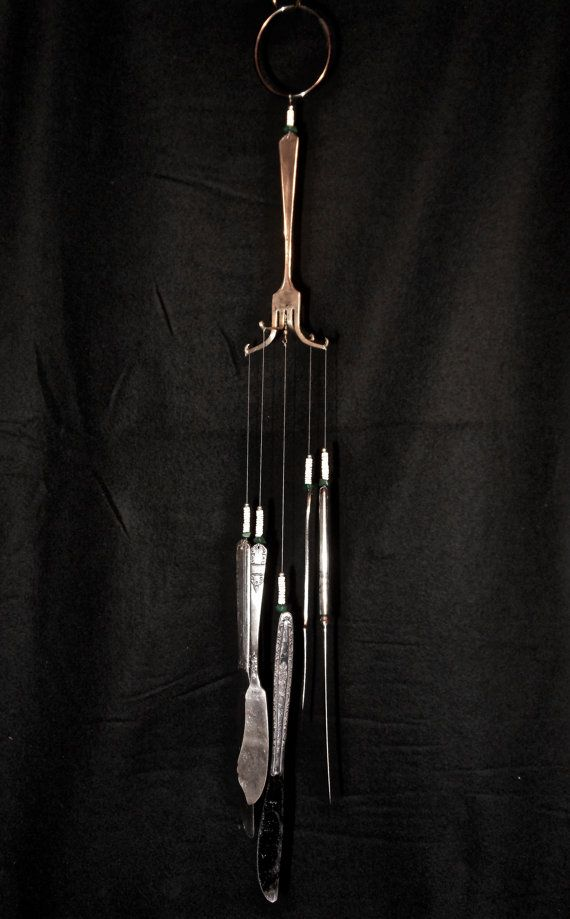 One of a kind windchime made of reused materials.
