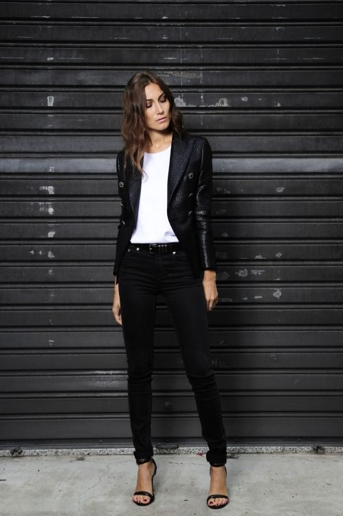 the sharp polished jacket and the strappy heels give this an edgy vibe