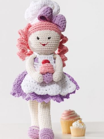With her chef's hat and cute #crochet #cupcakes, Baker Lily is ready to make some sweet treats for her next tea party!
