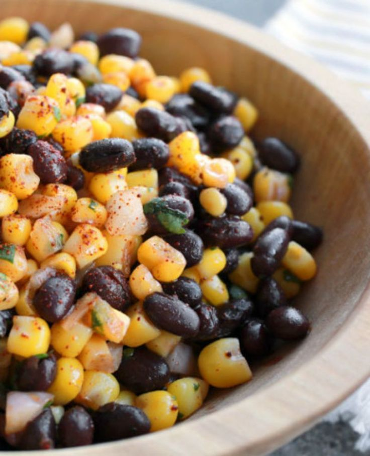 We intended to make this corn and black bean salad recipe as a salsa, but when it came out of the test kitchen, staffers couldn't refrain from shoveling it in their mouths with a spoon! Hence—it became one our latest favorite salad (main course or side).