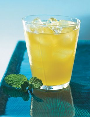 POM Australia Day Cocktail - made with POMx Pomegranate Lychee Green Tea, orange juice, and mint leaves.