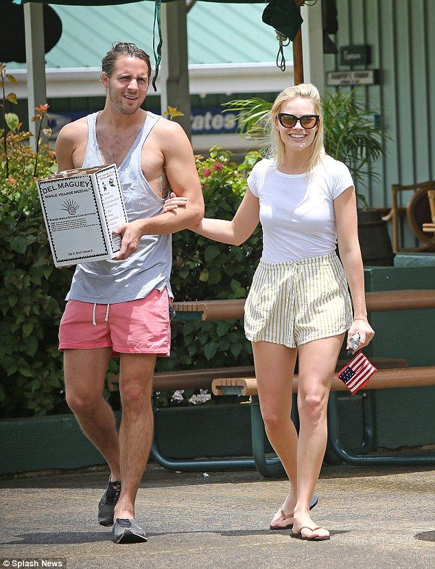 Casual but cute: Margot teamed some striped shorts with a white t-shirt and flip-flops for the outing