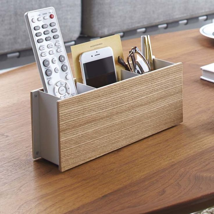 Features:  -Ideal for holding remote controls, smartphones, mail, pens and more.  -Design: Contemporary.  -Distressed: No.  Product Type: -Remote Control Holder. Dimensions:  Overall Height - Top to B