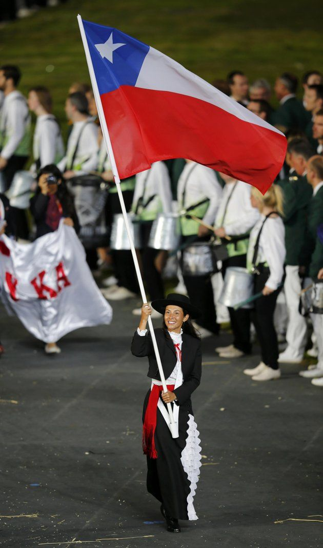 Chile's flag bearer Denisse van Lamoen holds the national flag as she leads the contingent in the athletes parade during the opening ceremony of the London 2012 Olympic Games at the Olympic Stadium July 27, 2012.