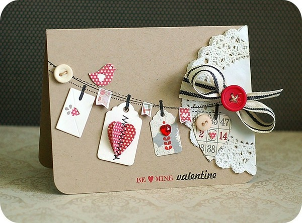Note: kraft paper, crisp white doily, stitched washing line, red accents.