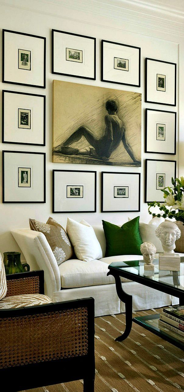Captivating is the best way to describe this wall gallery and living room design. Loving the simple frames and the symmetry that sits around the main portrait.