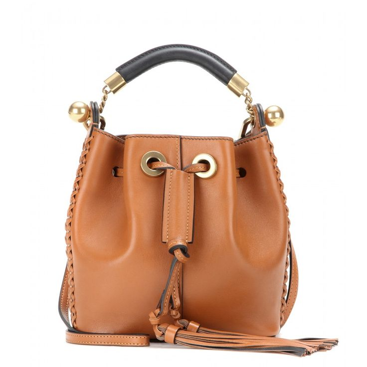 Chloé - Gala Small leather bucket bag - You can't go wrong with a bucket bag this season. Chloé's 'Gala' has been downsized to a more compact design, making it an easy everyday favourite. The rich tan leather will team effortlessly with all your favourite wardrobe pieces. We love the stitching detail that gives it a boho look. seen @ www.mytheresa.com