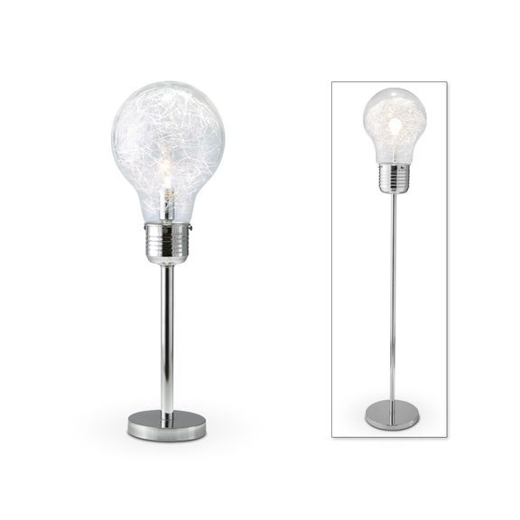 Idealistic Lumens. What a great idea - to design a lamp collection in light of its purpose. Within the clear glass, bulb-shaped Light Bulb lamps, metallic confetti meant to look like electric filaments surround the real light bulb. A switch turns the light off at the bottom of the faux bulb. Customer assembly is required.