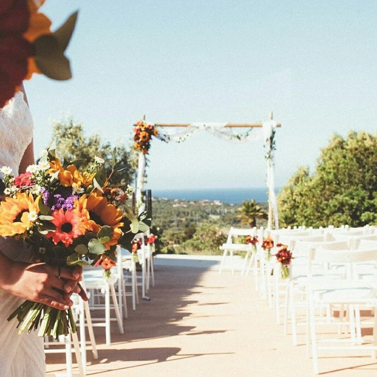Last Saturday's wedding with Deliciously Sorted Mallorca. Gorgeous colourful sunflower bouquets and olive foliage along the tables -  Photo courtesy of http://www.aimeek-photography.com/