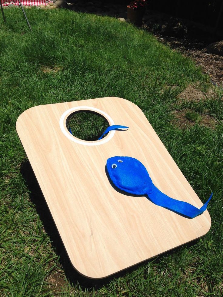 sperm bean bag toss game.  Made with beans and felt.  baby shower game for circus or carnival themed party