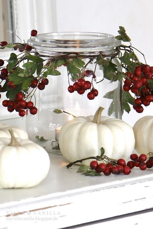 Glass jar with berries around the lip for a different take on a candle holder. Of course, no pumpkin for Christmas!