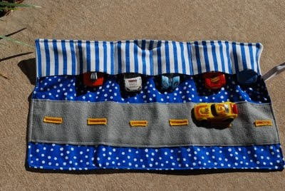 i need to make this. one for each of my boys since they both love to take a zillion cars in the car with us on trips.! this way they arent all over the place!