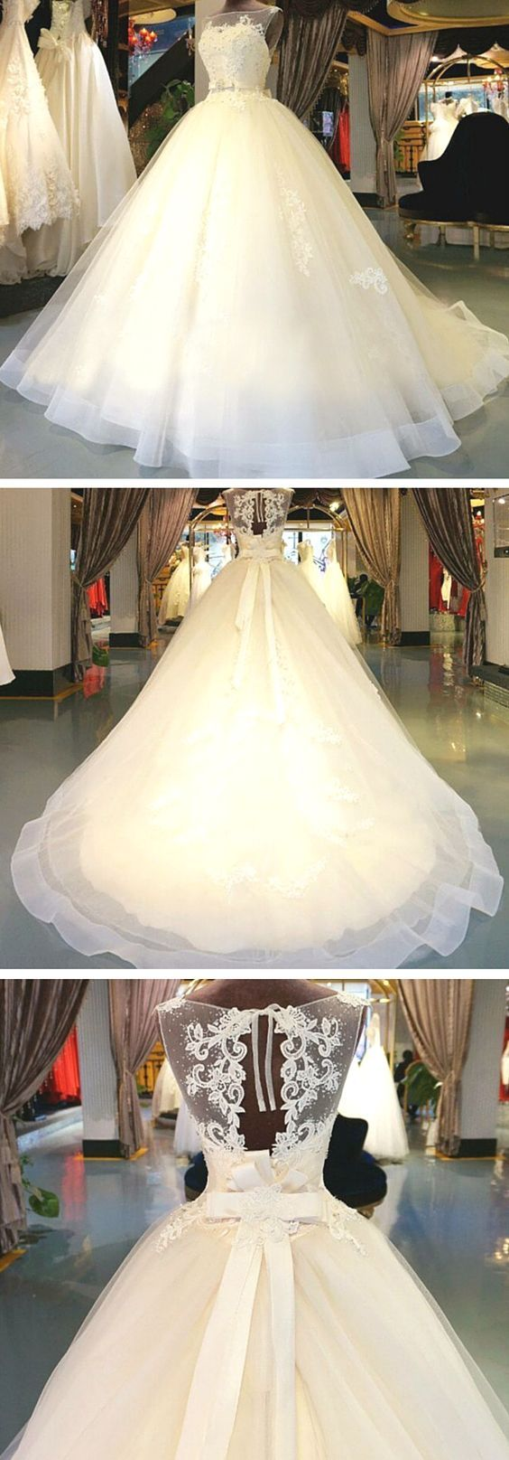Embellished lace and crystal tulle chapel train wedding dress. This gown is intr...