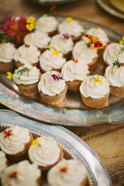 Cake love: a wedding cake feast decorated with summer blooms and edible flowers