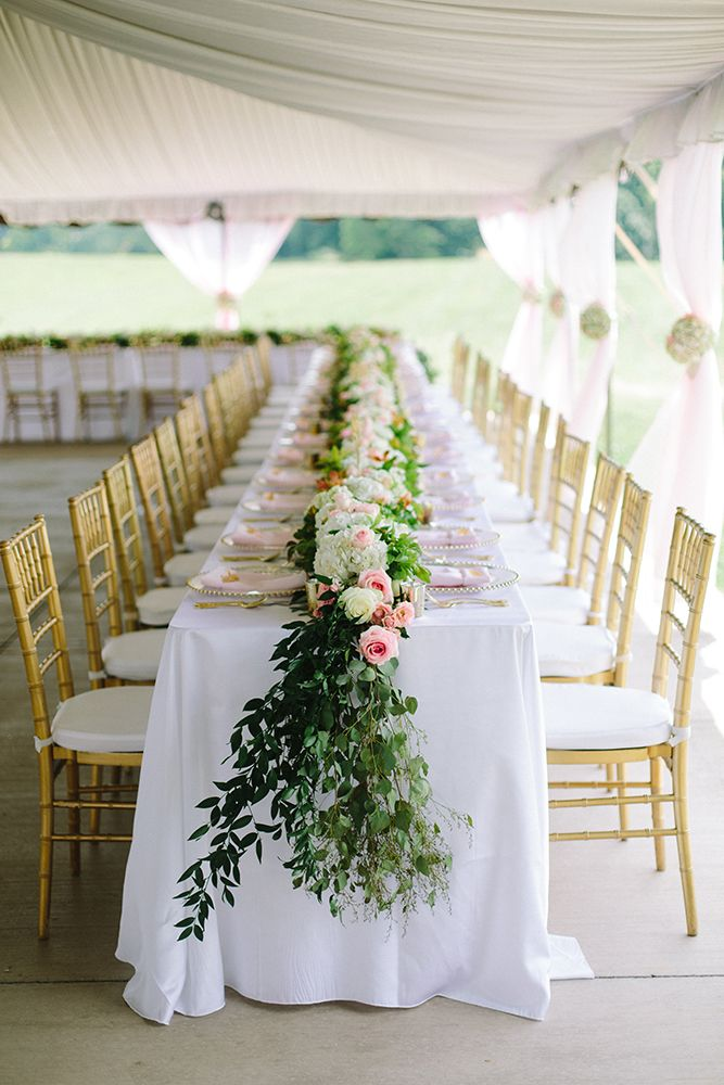 We love these beautiful floral arrangements with the gold chiavari chairs by Celebrate Rentals! They have rentals for any wedding you envision. Click the image to learn more. Photo credit: JoPhoto