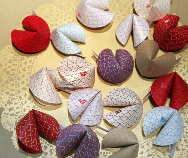 Here's the tutorial for the paper fortune cookies. I put little love notes in mine for Valentines Day, but this could also be fun for Chinese New Year- or think how cute they would be scattered on a table for...