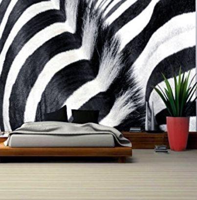 Giant zebra print wallpaper.  Dramatic zebra stripes wallpaper on a bedroom room wall.