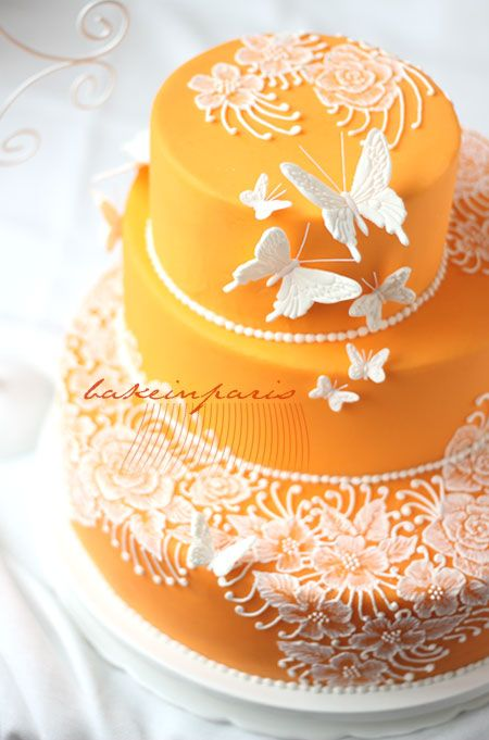 Best for Orange and White wedding theme. Brush embroidery cake. This is done in royal icing but also can be done in buttercream
