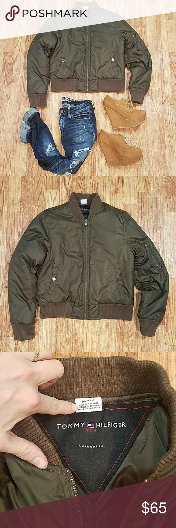 Tommy Hilfiger Army Green Puffer Bomber Jacket Great used condition!! Slight wear with very faint marks here and there. Freshly laundered and ready to wear! Small pin hole on the front from a deceptive pin that did not come with the coat (happy to include the pin 😉). In the correct light there is a line  in the fabric that goes around the jacket. Hard to picture, but it's not significant and I think it's always been there. In the last photo you can make it out under the shadow of my hand…