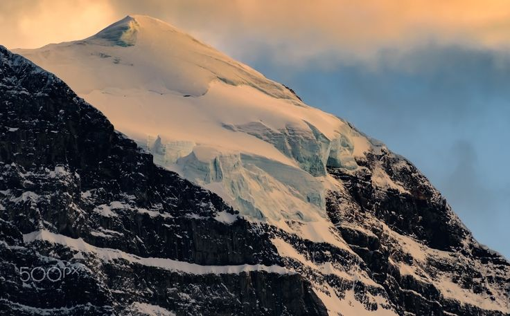 Frozen Light Point - The last bit of sunlight reflecting from a ice covered mountain top