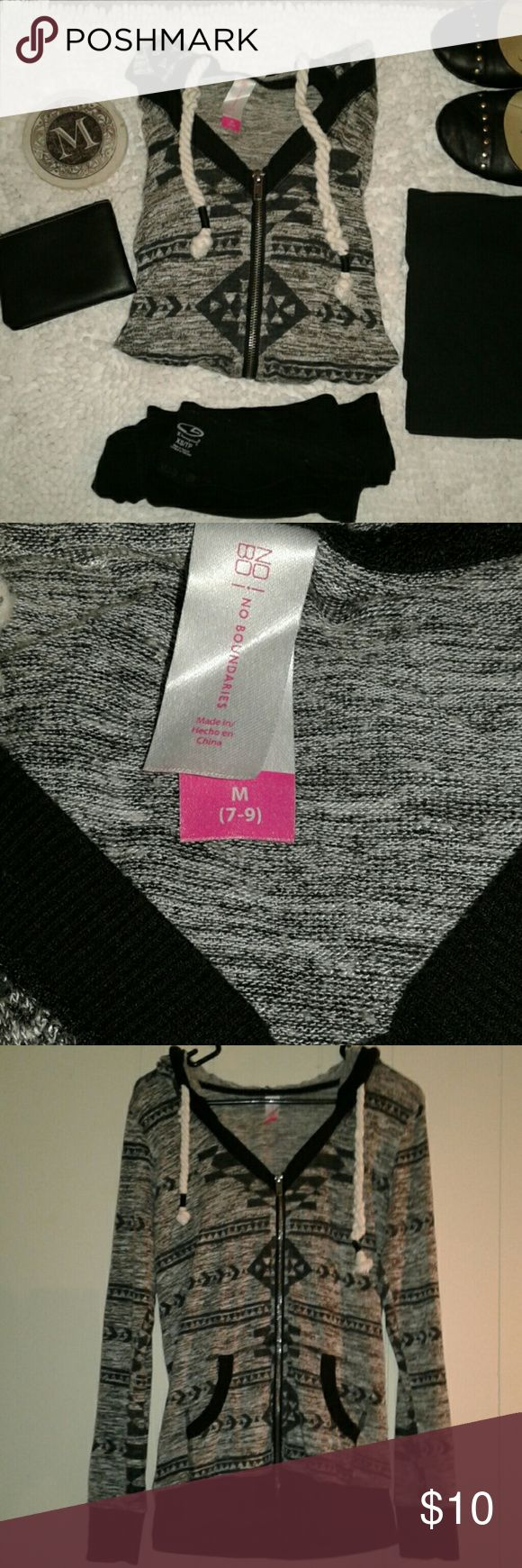 """Scoop neck Aztec zip up hoodie medium EUC Grey & black Aztec pattern lightweight knit scoop neck full zip hooded sweatshirt. Size medium by No Boundaries. Tunic length approx 25"""" from shoulder to bottom hemline. Cute braided rope detail drawstrings 67% Rayon/ 29% polyester/4% spandex materials.   PERFECT FOR FALL!  NO TRADES PLEASE DO NOT LOWBALL ME BUNDLE 20% DISCOUNT! No Boundaries Tops Sweatshirts & Hoodies"""