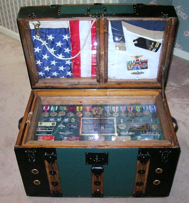 Another nice shadow box idea. Antique Trunk Used as Navy Retirement Shadowbox Antique Trunk and Storage Chest