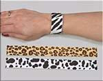 Come on, admit it.  You had a ton of slap bracelets too, didn't you?