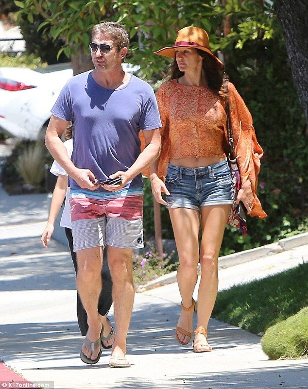 Love in the sun: Gerard Butler and his girlfriend Morgan Brown looked relaxed in their sum...