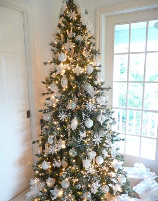 Traditional Christmas tree with all-white decorations and sparking lights