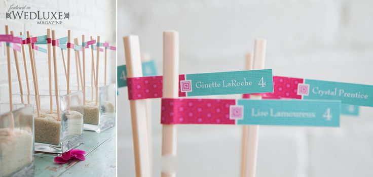 Unique place card flags displayed on chopsticks.  As seen in wedluxe magazine