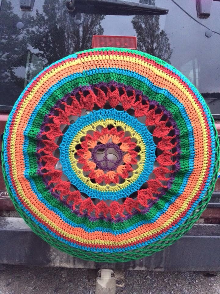 A jeep tire cover for the MALA mobile to celebrate World Wide Knit in Public Day 2015