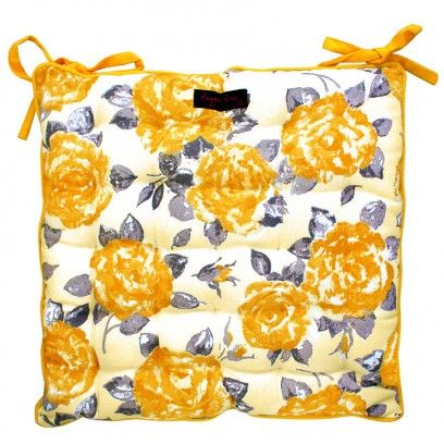 The perfect seat pad to brighten up any room. The perfect floral pattern for kitchen and garden chairs in a gorgeous yellow mustard colour - 100% cotton fabric - Quilt tucked stitching throughout -  Thickly padded - Extra ties -  Size 40cm x 40cm -  Machine washable at 40 degrees but treat gently, do not spin - Leave the cushion seat pad to dry flat - Co-ordinating table linen and cushions available