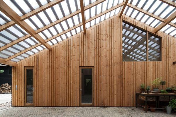 Schuur met appartement op landgoed Rijswijk - architectenweb.nl