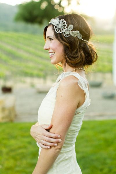 A crystal headpiece adds the perfect finishing touch for this lovely Bridal updo. #wedding #hairstyle #accessories