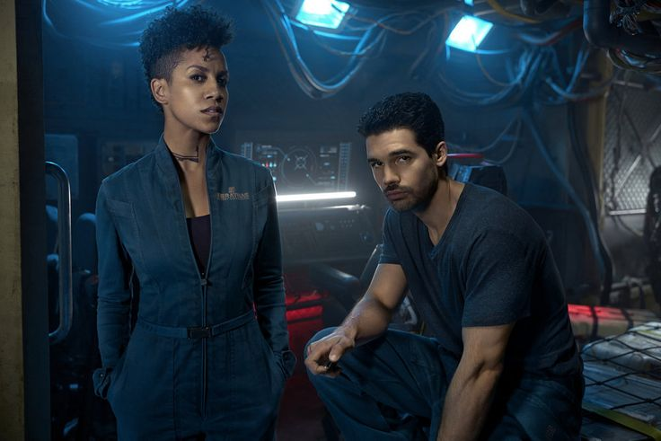 (Left to right): Dominique Tipper as Naomi Nagata, Steven Strait as Earther James Holden. Credit: Kurt Iswarienko/Syfy