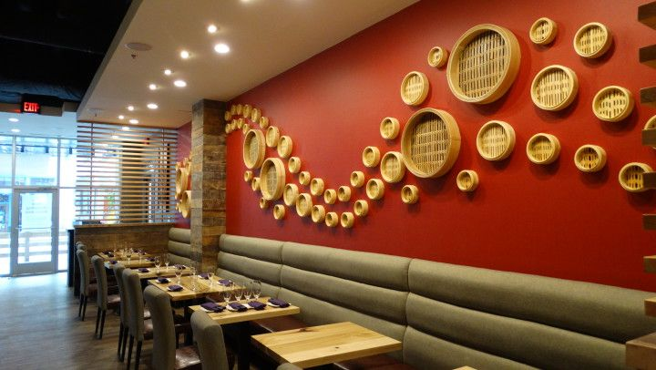 Traditional bamboo steamer baskets line the wall at the newly opened Red Ginger Dimsum & Tapas restaurant. (Photo by Krista L. White)