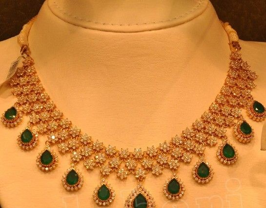 Round diamonds studded star model clasps intricate classy triple rows merged unique diamond necklace, edged with oval shaped dark emerald...