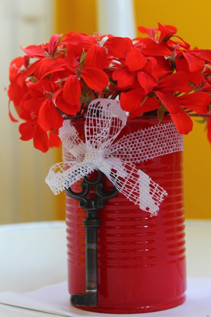 Really simple vase. I took an empty can, painted it red, left it for the night to dry. The next day I tied an old key to it, using a piece of lace. I think the result is lovely..:)