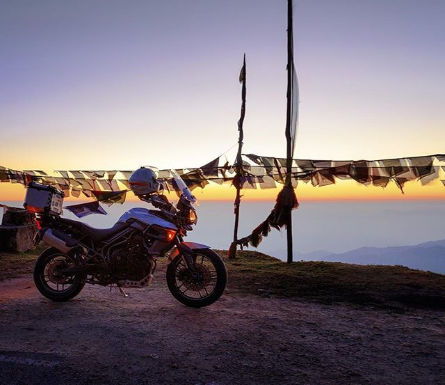 She Takes Me Places  Thrills Me With Her Paces Graces A Special Space  In My Chase For Peace . . . . . . . . . . . . #TigerDiaries #TriumphTiger #Tiger #Triumph #Times2Travel #travel #sunset #goldenhour #Bhutan #Phuentsholing #ride #rider #motorcycle #flag #adventure #advrider #adv