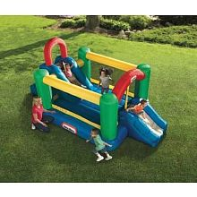 Huge inflatable gym measures 9'' x 14'' x 7'' feet. Includes large climbing wall that leads to a 4'' high slide into the bouncer. Tall, protective walls surround a large jumping area, including 2 big slides with slide rails. Stakes anchor the bouncer firmly in place. Heavy-duty blower provides continuous airflow. Built with puncture resistant materials with durable mesh netting.